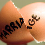 Broken egg shell with the word marriage